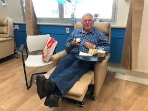 Patient Kevin Solly celebrating Windsor Gardens Day Surgery's first birthday